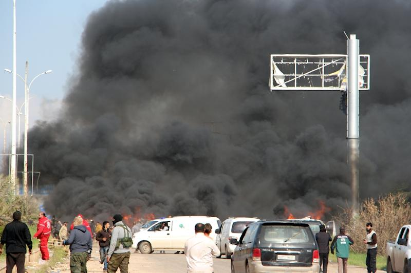 Smoke billows from the site of a suicide car bombing in Rashidin, west of Aleppo, that targeted buses carrying Syrian evacuees on April 15, 2017 (AFP Photo/Ibrahim YASOUF)