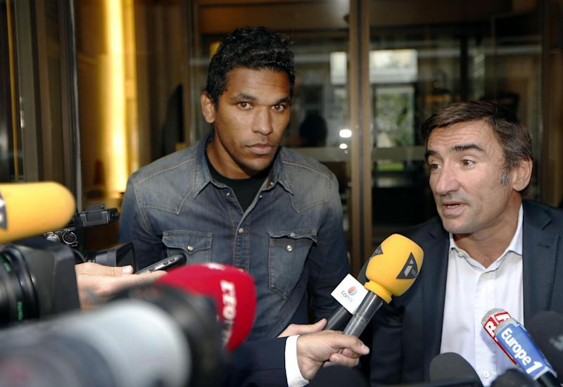 Bastia's Brazilian forward Brandao (L) and his lawyer Olivier Martin speak to the press after a hearing at the French professional fooball league on August 21, 2014, in Paris (AFP Photo/Thomas Samson)