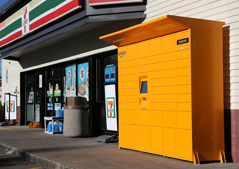 A bright yellow Amazon storage locker is pictured outside a 7-Eleven in Boston. The high-tech lockers claim to prevent the theft of deliveries from your doorstep by package pirates. (Photo by David L. Ryan/The Boston Globe via Getty Images)