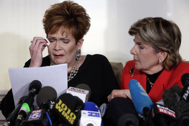 "Beverly Young Nelson, left, the latest accuser of Alabama Republican Roy Moore, reads her statement as attorney Gloria Allred looks on, at a Nov. 13 news conference in New York. Nelson says Moore assaulted her when she was 16 and offered her a ride home from a restaurant where she worked. Moore says the latest allegations against him are a ""witch hunt."" (Photo: Richard Drew/AP)"