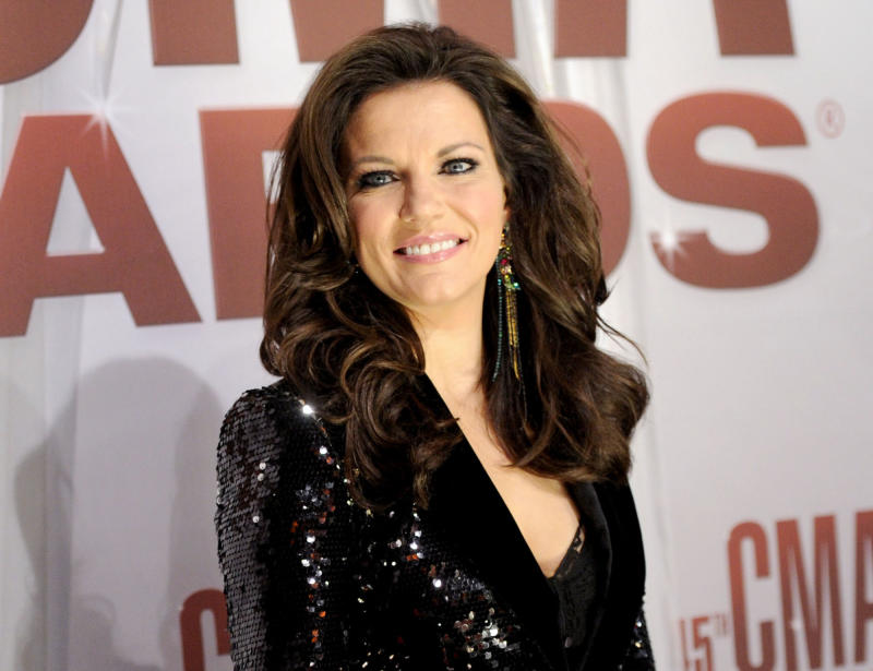 """FILE - In this Nov. 9, 2011 file photo, singer Martina McBride arrives at the 45th Annual CMA Awards in Nashville.  McBride will perform her new single, """"Marry Me,"""" with Train lead singer Pat Monahan while a couple from New Jersey gets married on stage at the Academy of Country Music Awards Sunday April 1, 2012. (AP Photo/Evan Agostini, file)"""