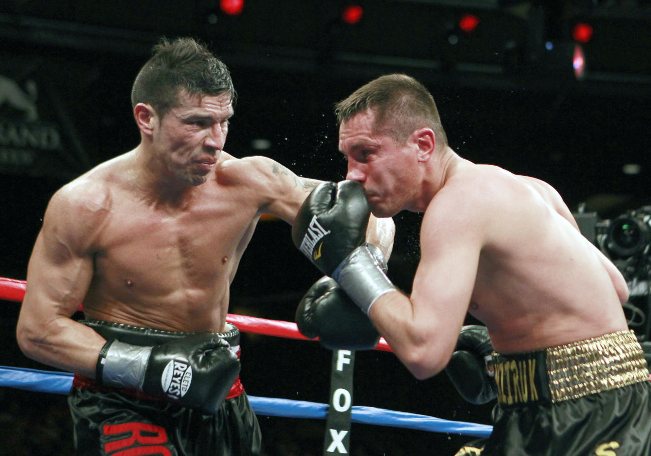 Sergio Martinez, left, lands a punch on Sergiy Dzinziruk, of Germany, in the sixth round of their WBC middleweight title boxing match in Mashantucket, Conn., Saturday, March 12, 2011. Martinez won in the eighth round on a TKO.