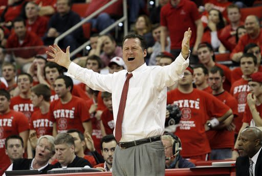 North Carolina State's head coach Mark Gottfried reacts to call during the second half of an NCAA college basketball game against Virginia in Raleigh, N.C., Saturday, Jan. 28, 2012. Virginia won 61-60. (AP Photo/Jim R. Bounds)