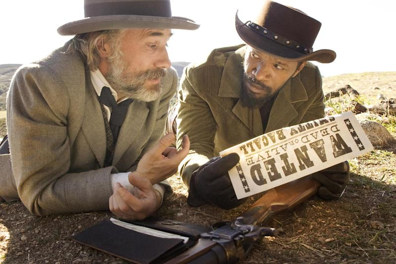 """FILE - This undated publicity image released by The Weinstein Company shows, from left, Christoph Waltz as Schultz and Jamie Foxx as Django in """"Django Unchained,"""" directed by Quentin Tarantino. In Los Angeles, the Weinstein Co. canceled Tuesday, Dec. 18, 2012, planned premiere of the violent movie """"Django Unchained."""" (AP Photo/The Weinstein Company, Andrew Cooper, SMPSP, File)"""