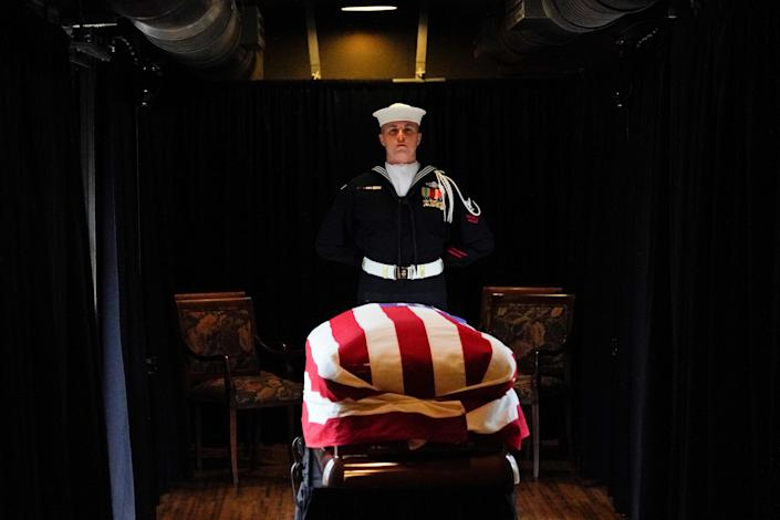 The flag-draped casket of former President George H.W. Bush passes through Magnolia, Texas, Thursday, Dec. 6, 2018, along the route from Spring to College Station, Texas. (Photo: David J. Phillip/Pool via Reuters)