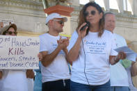 Casino dealer Nicole Vitola speaks at a rally Wednesday, June 30, 2021 on the Atlantic City N.J., Boardwalk calling for a permanent ban on smoking in Atlantic City's nine casinos. The coronavirus-inspired temporary ban will expire on Sunday July 4. (AP Photo/Wayne Parry)