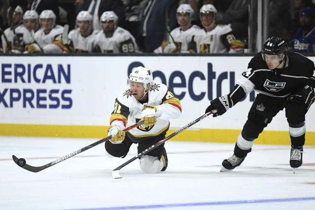 Vegas Golden Knights center Jonathan Marchessault, left, passes the puck as Los Angeles Kings defenseman Tobias Bjornfot reaches for it during the third period of a preseason NHL hockey game Thursday, Sept. 19, 2019, in Los Angeles. (AP Photo/Mark J. Terrill)