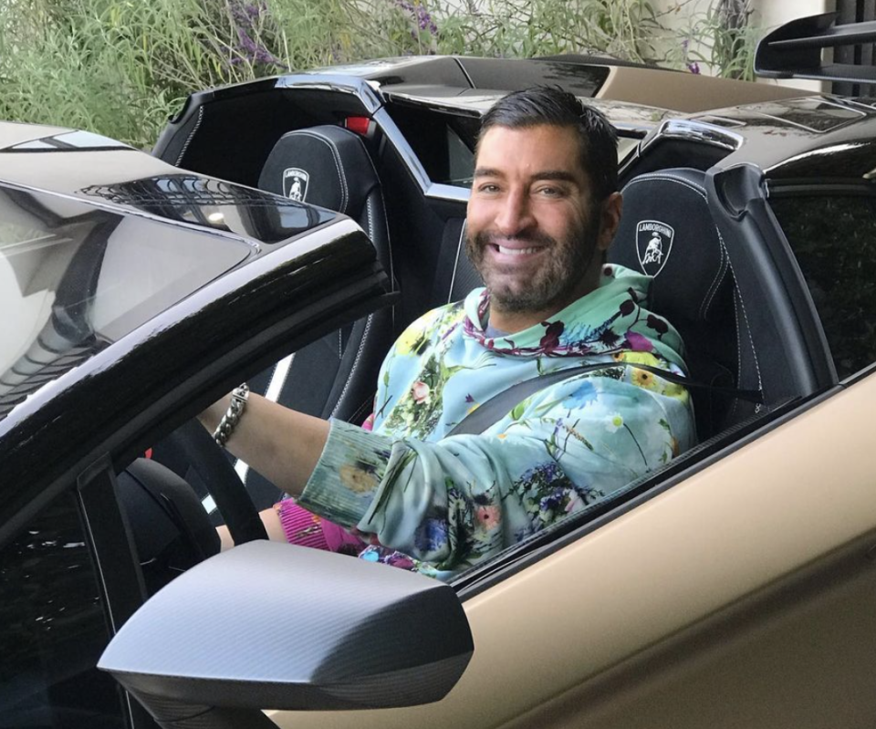 James Khuri is pictured behind the wheel of a Lamborghini.
