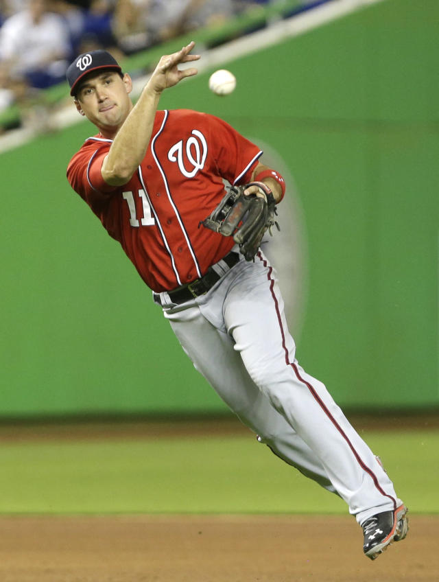 Washington Nationals third baseman Ryan Zimmerman throws to first to put out Miami Marlins' Jeff Mathis during the sixth inning of a baseball game, Saturday, Sept. 7, 2013, in Miami. (AP Photo/Wilfredo Lee)