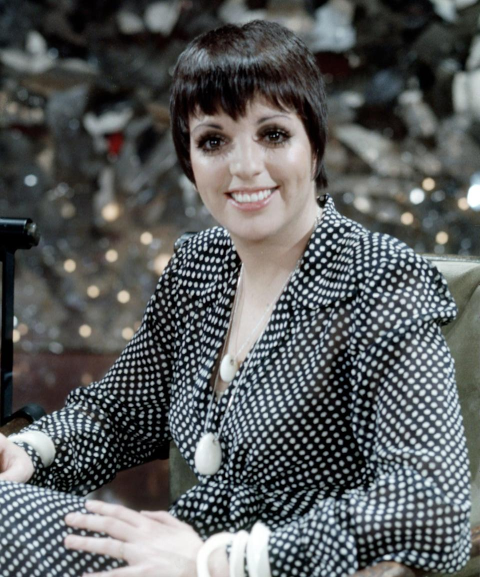 """<h2>The Real Liza Minnelli</h2><br>It might be safe to assume you know the <a href=""""https://www.refinery29.com/en-gb/2019/09/8489670/liza-minelli-relationship-judy-garland-film"""" rel=""""nofollow noopener"""" target=""""_blank"""" data-ylk=""""slk:name Liza Minnelli"""" class=""""link rapid-noclick-resp"""">name Liza Minnelli</a>, but just in case, here goes: Judy Garland's equally famous daughter has spent the better part of the last century entertainer on the stage, screen, and television — an yes, she's got an EGOT winner. But before she started sweeping award shows, Minnelli was one of Halston's good friends and muses. He designed the costumes for all her live performances, in addition to the famous yellow gown she wore in 1972 when she won the Oscar for her role in <em>Cabaret</em>. <span class=""""copyright"""">Photo: Michael Ochs Archives/Getty Images.</span>"""