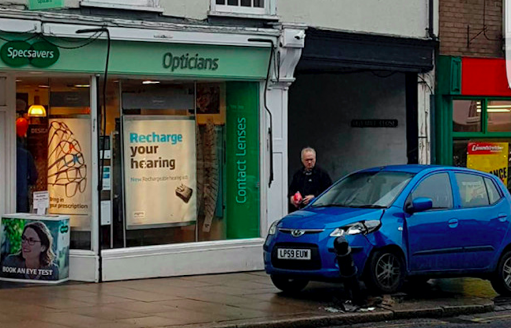 Ironic: The pensioner crashed the car right outside a branch of Specsavers (SWNS)
