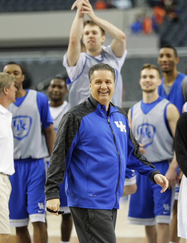 Kentucky head coach John Calipari shares a light moment with the team during practice for their NCAA Final Four tournament college basketball semifinal game Friday, April 4, 2014, in Dallas. Kentucky plays Wisconsin on Saturday, April 5, 2014. (AP Photo/Eric Gay)