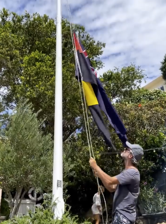 In one video, you can see the Aboriginal flag is flying upside down. Photo: Instagram/Pip Edwards