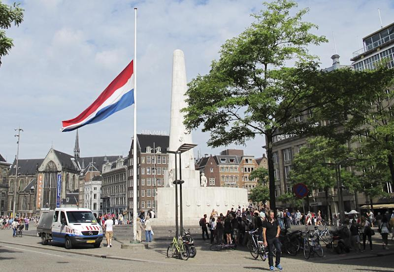 A flag is flying at half-staff at Dam Square in Amsterdam, Friday, Aug. 16, 2013. Members of the Dutch royal family and a small collection of friends are attending a private funeral for Prince Friso, who died this week due to complications from a 2012 skiing accident. He died on Monday, aged 44. Flags are flying at half-staff on official buildings around the country, and thousands of Dutch people have sent messages of condolences via social media. Friso is survived by his wife, Princess Mabel, and two young daughters. (AP Photo/Margriet Faber)