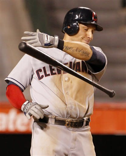 With two runners aboard, Cleveland Indians' Asdrubal Cabrera throws hit bat in frustration after striking out swinging to retire the side against the Los Angeles Angels in the seventh inning of a baseball game in Anaheim, Calif., Tuesday, Aug. 14, 2012. (AP Photo/Reed Saxon)