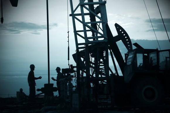 Oil workers at a drilling site.