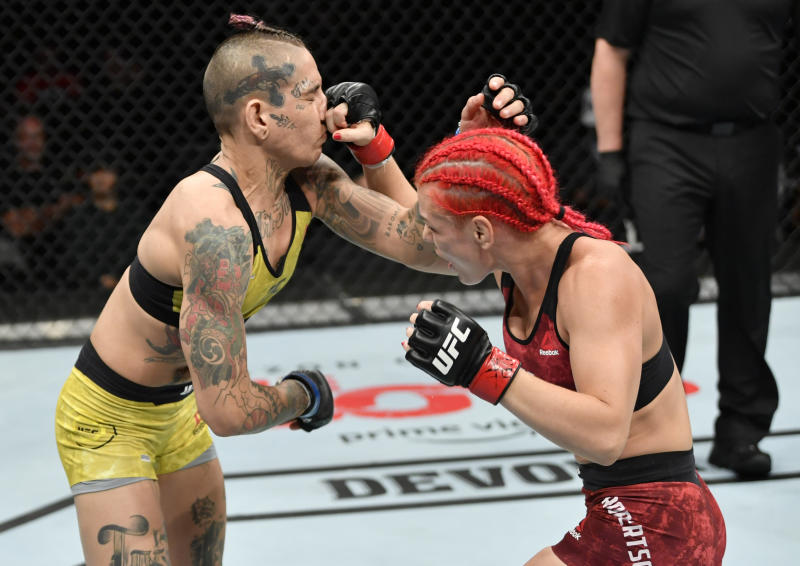 EDMONTON, ALBERTA - JULY 27: (R-L) Gillian Robertson of Canada punches Sarah Frota of Brazil in their flyweight bout during the UFC 240 event at Rogers Place on July 27, 2019 in Edmonton, Alberta, Canada. (Photo by Jeff Bottari/Zuffa LLC/Zuffa LLC)