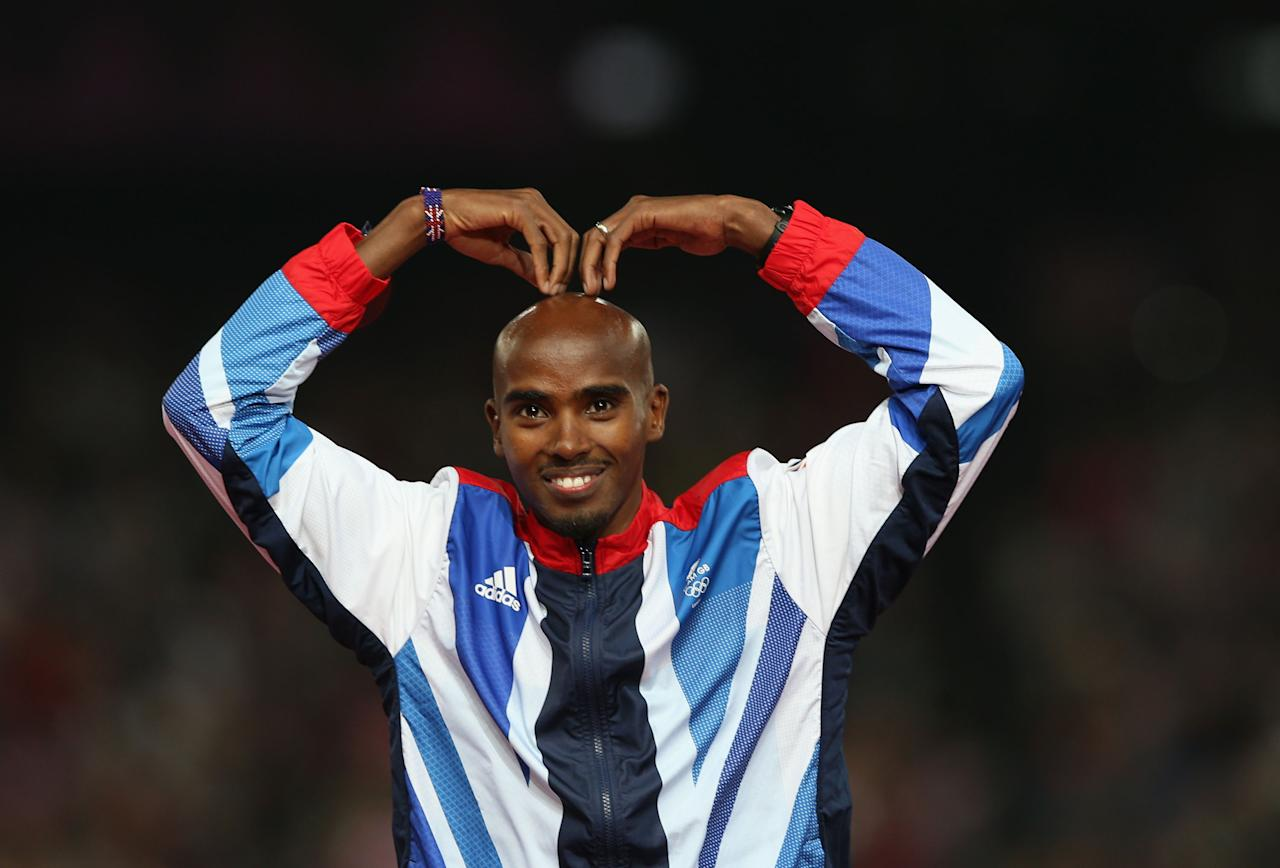 Gold medalist Mohamed Farah of Great Britain celebrates on the podium during the medal ceremony for the Men's 5000m on Day 15 of the London 2012 Olympic Games at Olympic Stadium on August 11, 2012 in London, England.  (Photo by Clive Brunskill/Getty Images)