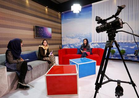 Afghan presenters record their morning programme at the Zan TV station (women's TV) in Kabul