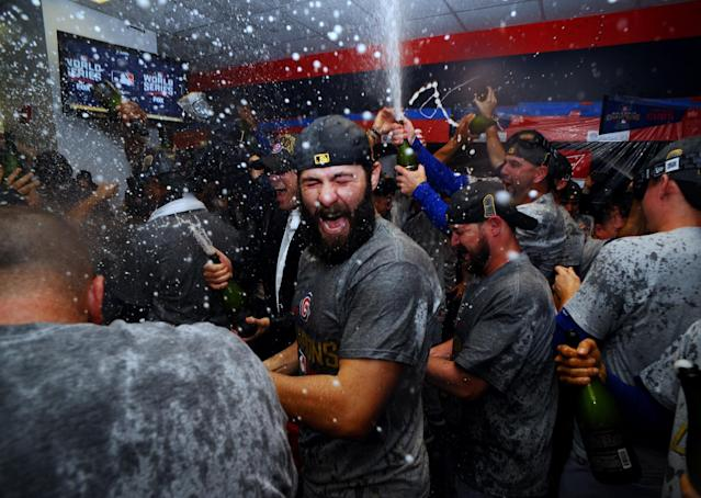 <p>Chicago Cubs starting pitcher Jake Arrieta celebrates in the clubhouse after defeating the Cleveland Indians in game seven of the 2016 World Series at Progressive Field. Mandatory Credit: Ken Blaze-USA TODAY Sports </p>