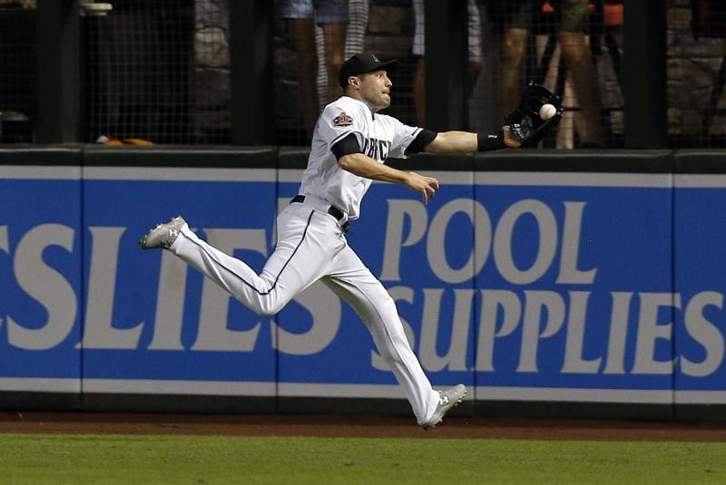 Arizona Diamondbacks center fielder A.J. Pollock makes the running catch on a ball hit by Chicago Cubs' Albert Almora Jr. during the fifth inning of a baseball game Tuesday, Sept. 18, 2018, in Phoenix. (AP Photo/Rick Scuteri)