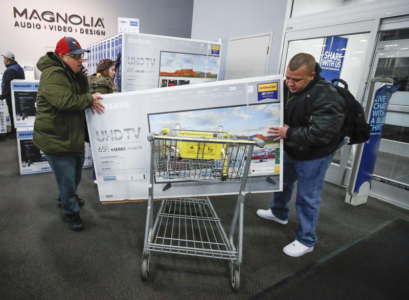 CHICAGO, IL - NOVEMBER 22: Shoppers load a big screen TV into their cart at a Best Buy Inc. store on November 22, 2018 in Chicago, Illinois. Known as 'Black Friday', the day after Thanksgiving marks the beginning of the holiday shopping season, with many retailers opening their doors on Thursday evening. (Photo by Kamil Krzaczynski/Getty Images)