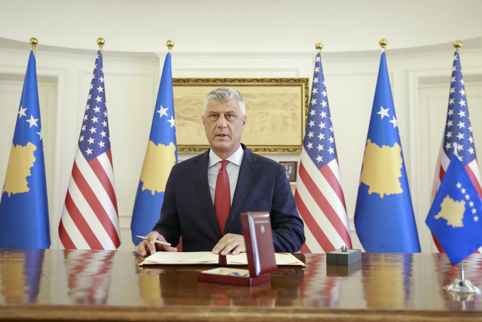 Kosovo's President Hashim Thaci signs the Order of Freedom awarded to U.S President Donald Trump, in capital Pristina, Kosovo on Friday, Sept. 18, 2020. Kosovo's president awarded U.S. President Donald Trump with one of the country's highest medals - Kosovo's Order of Freedom - for his government's efforts on peace and reconciliation in the former war-torn region. (AP Photo/Visar Kryeziu)