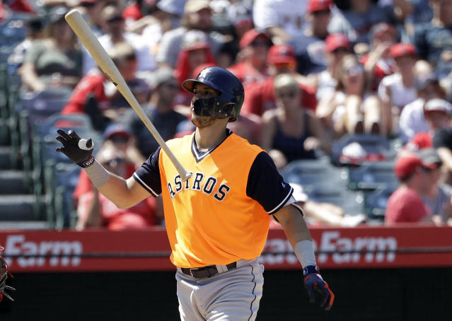 Houston Astros' Carlos Correa flips his bat after striking out during the fifth inning of a baseball game against the Los Angeles Angels, Sunday, Aug. 26, 2018, in Anaheim, Calif. (AP Photo/Marcio Jose Sanchez)