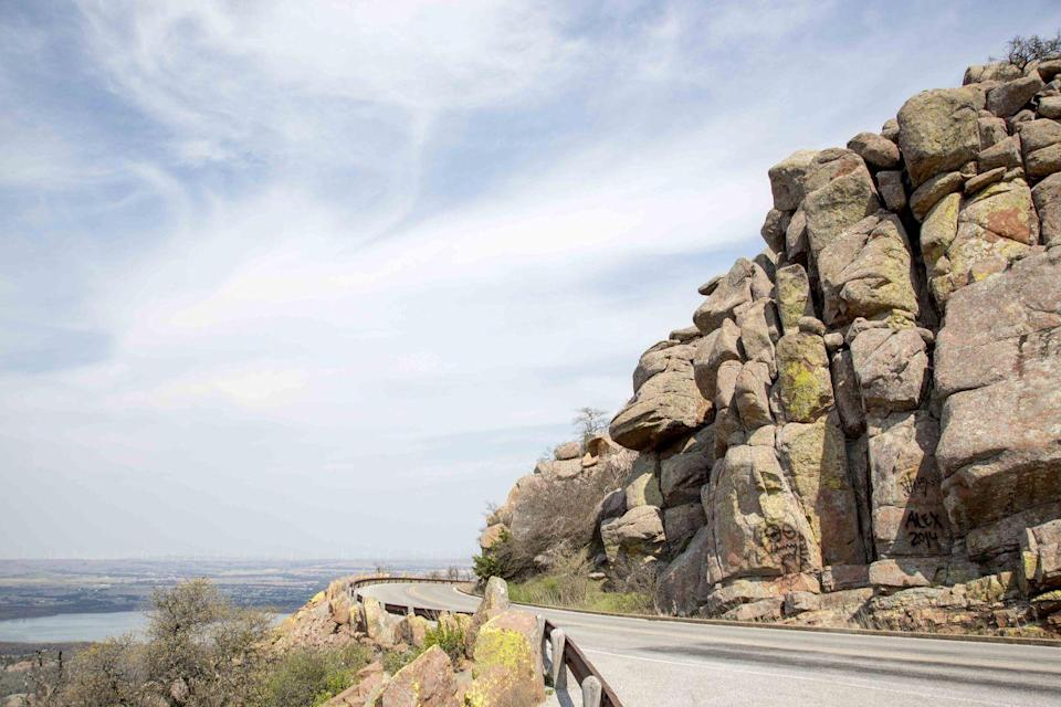 """<p><strong>The Drive: </strong><a href=""""https://www.tripadvisor.com/ShowUserReviews-g51429-d117490-r157970694-Wichita_Mountains_National_Wildlife_Refuge-Indiahoma_Oklahoma.html"""" rel=""""nofollow noopener"""" target=""""_blank"""" data-ylk=""""slk:Wichita Mountains Scenic Byway"""" class=""""link rapid-noclick-resp"""">Wichita Mountains Scenic Byway</a></p><p><strong>The Scene: </strong>Located in southwestern Oklahoma, the <a href=""""https://www.tripadvisor.com/Attraction_Review-g51429-d117490-Reviews-Wichita_Mountains_National_Wildlife_Refuge-Indiahoma_Oklahoma.html"""" rel=""""nofollow noopener"""" target=""""_blank"""" data-ylk=""""slk:Wichita Mountains"""" class=""""link rapid-noclick-resp"""">Wichita Mountains</a> Scenic Byway offers some of the prettiest wildflower sightings in the spring, and amazing fall foliage views in the fall.</p><p><strong>The Pit-Stop: </strong>Climb <a href=""""https://www.tripadvisor.com/ShowUserReviews-g51429-d117490-r131070249-Wichita_Mountains_National_Wildlife_Refuge-Indiahoma_Oklahoma.html"""" rel=""""nofollow noopener"""" target=""""_blank"""" data-ylk=""""slk:Mt. Scott"""" class=""""link rapid-noclick-resp"""">Mt. Scott</a> to get a panoramic view of the surrounding mountains.</p>"""