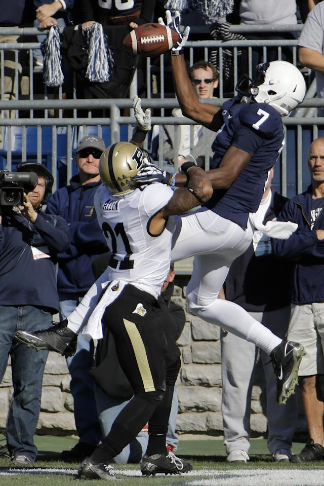 Penn State wide receiver Eugene Lewis (7) can't hang onto a pass in the end zone as Purdue cornerback Ricardo Allen (21) defends during the first quarter of an NCAA college football game in State College, Pa., Saturday, Nov. 16, 2013. (AP Photo/Gene J Puskar)