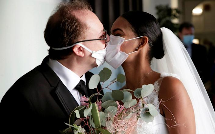 Attendees at weddings are currently limited to 30under government rules - CIRO DE LUCA/Reuters