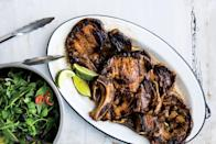 """A flavorful marinade and an herby plum salad transform pork chops into an irresistible summer meal. <a href=""""https://www.epicurious.com/recipes/food/views/vietnamese-style-pork-chops-with-fresh-herb-salad?mbid=synd_yahoo_rss"""" rel=""""nofollow noopener"""" target=""""_blank"""" data-ylk=""""slk:See recipe."""" class=""""link rapid-noclick-resp"""">See recipe.</a>"""