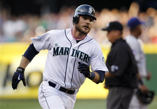 Seattle Mariners' John Jaso rounds the bases on his home run against the Texas Rangers in the fifth inning of a baseball game Saturday, July 14, 2012, in Seattle. (AP Photo/Elaine Thompson)