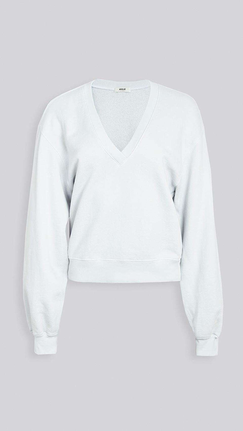 <p>We love the light blue color of this elevated <span>Agolde V Neck Balloon Sleeve Sweatshirt</span> ($138).</p>