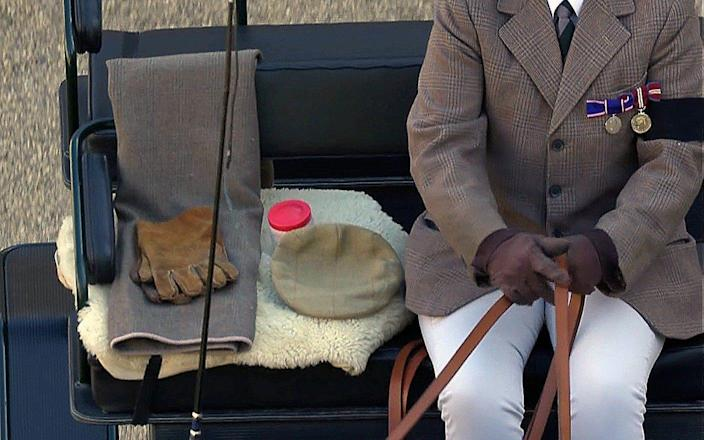 Reminders of the man: The Duke's whip, cap and gloves made an appearance with his riding carriage
