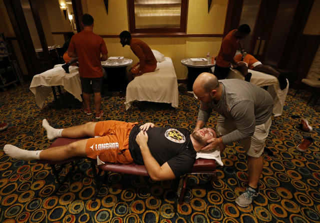 Texas Longhorns' Cort Jaquess is adjusted by team chiropractor Jordan Pellien Friday Sept. 6, 2019 at the team hotel in Austin, Tx. ( Photo by Edward A. Ornelas )