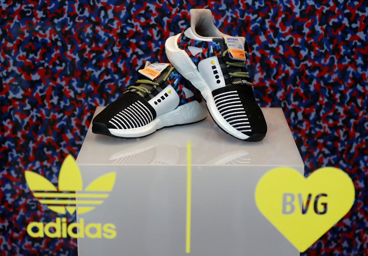The Adidas limited-edition sneakers that match the Berlin subway seat design, and include a yearly travel pass, are displayed at the 'Overkill' shoe store in Berlin, Germany January 16, 2018. REUTERS/Fabrizio Bensch