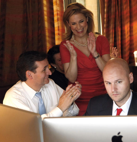 U.S. Senator candidate Ted Cruz, left, his wife Heidi, and his general consultant Jason Johnson react as they watched early returns in his war room at the JW Marriott in the Galleria during his runoff election against rival Republican Lt. Gov. David Dewhurst for the U.S. Senate seat vacated by Kay Bailey Hutchison Tuesday, July 31, 2012, in Houston. (AP Photo/Houston Chronicle, Johnny Hanson)