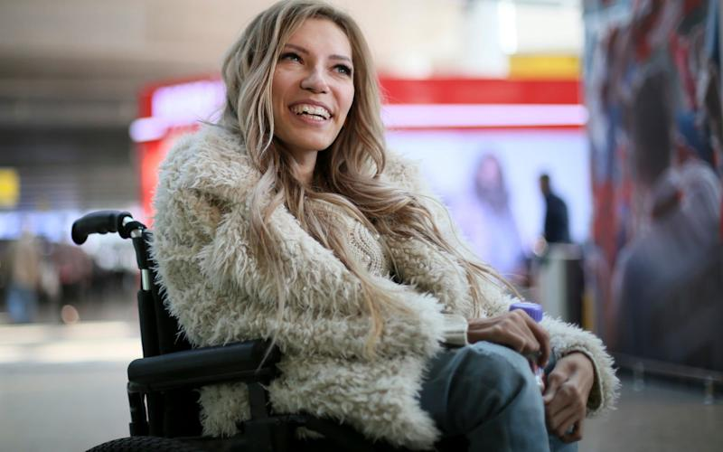 Russian singer Yulia Samoylova poses at Sheremetyevo airport outside Moscow, Russia on March 14 - AP