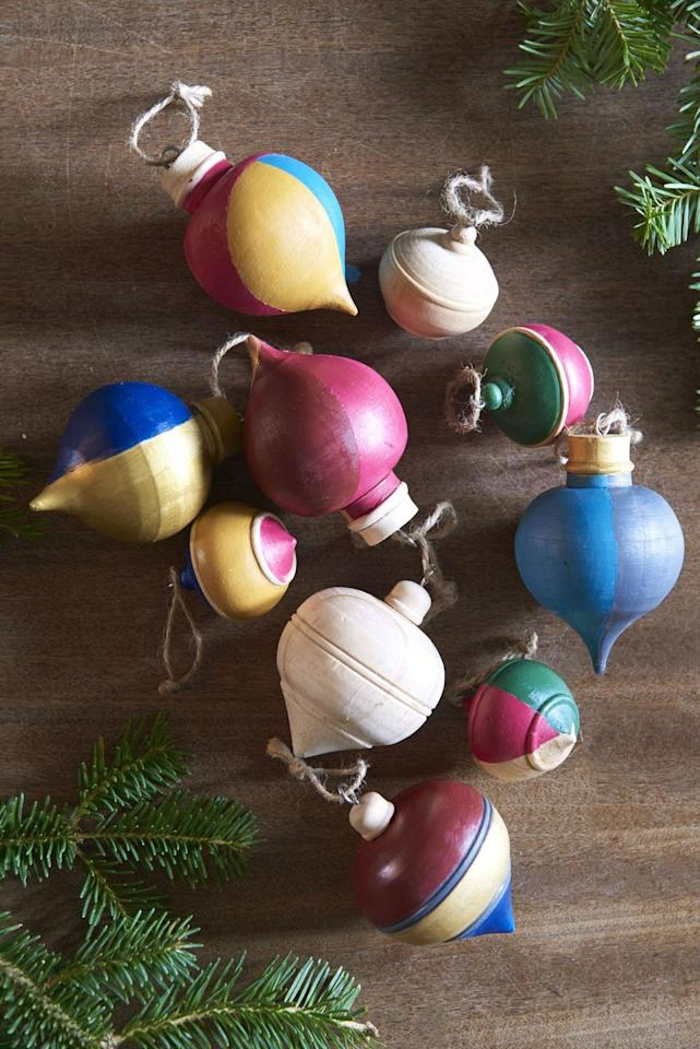 """<p>Rather than treading lightly around your Christmas tree in fear that ornaments will fall and break, paint a dozen wooden ornaments for a shatter-proof option.</p><p><strong>RELATED: </strong><a href=""""https://www.goodhousekeeping.com/holidays/christmas-ideas/g393/homemade-christmas-ornaments/"""" target=""""_blank"""">Homemade Ornaments to Make This Year</a></p>"""