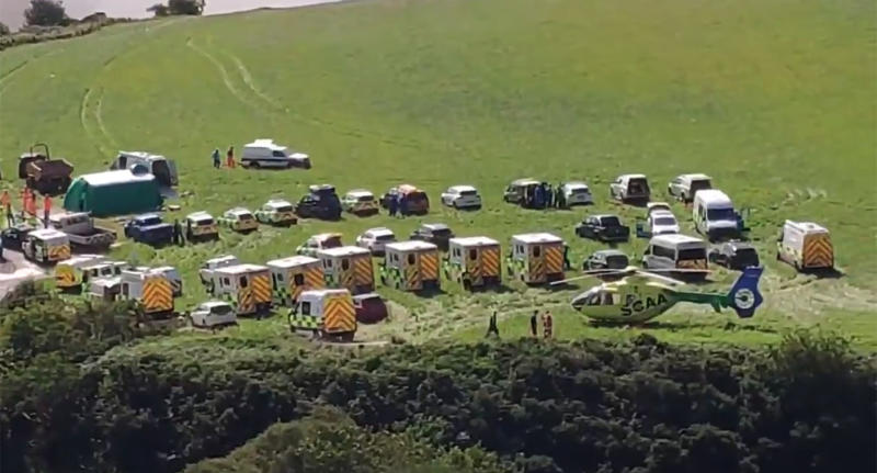 Emergency crews, including a helicopter and a number of ambulances, attend the scene at Stonehaven. Source: Twitter