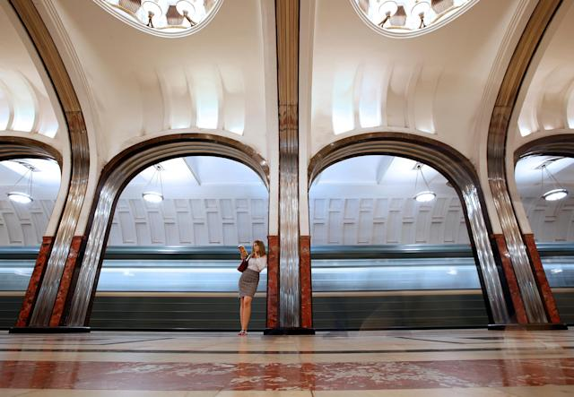 A woman reads a book at Mayakovskaya metro station in Moscow, Russia, June 22, 2018. As well as shooting all the matches, Reuters photographers are producing pictures showing their own quirky view from the sidelines of the World Cup. REUTERS/Christian Hartmann TPX IMAGES OF THE DAY