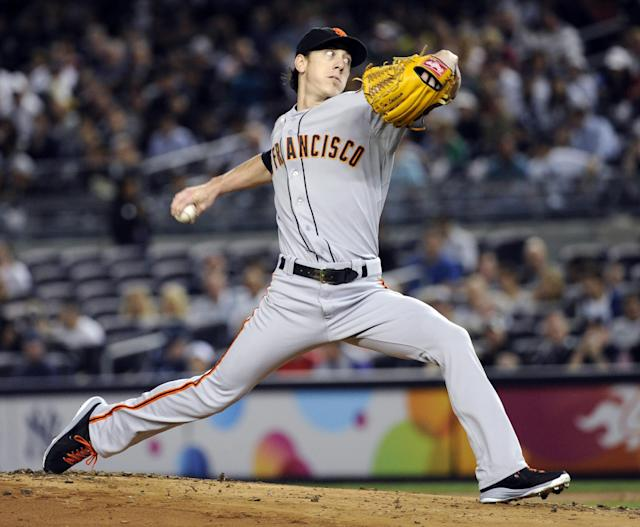 San Francisco Giants pitcher Tim Lincecum delivers during the first inning of an interleague baseball game against the New York Yankees, Friday, Sept. 20, 2013, at Yankee Stadium in New York. (AP Photo/Bill Kostroun)