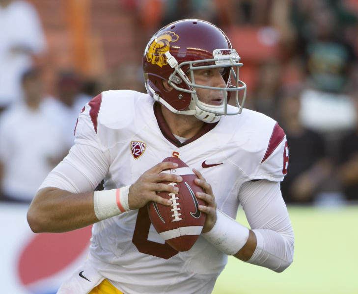 Southern California quarterback Cody Kessler (6) rolls out to pass while playing against Hawaii during the second quarter of an NCAA college football game Thursday, Aug. 29, 2013, in Honolulu. (AP Photo/Eugene Tanner)