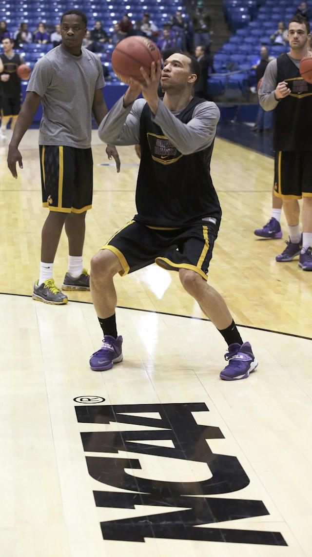 Albany forward Gary Johnson shoots during practice for an NCAA college basketball tournament game, Monday, March 17, 2014, in Dayton, Ohio. Albany plays Mount St. Mary's Tuesday evening in a first round game. (AP Photo/Al Behrman)