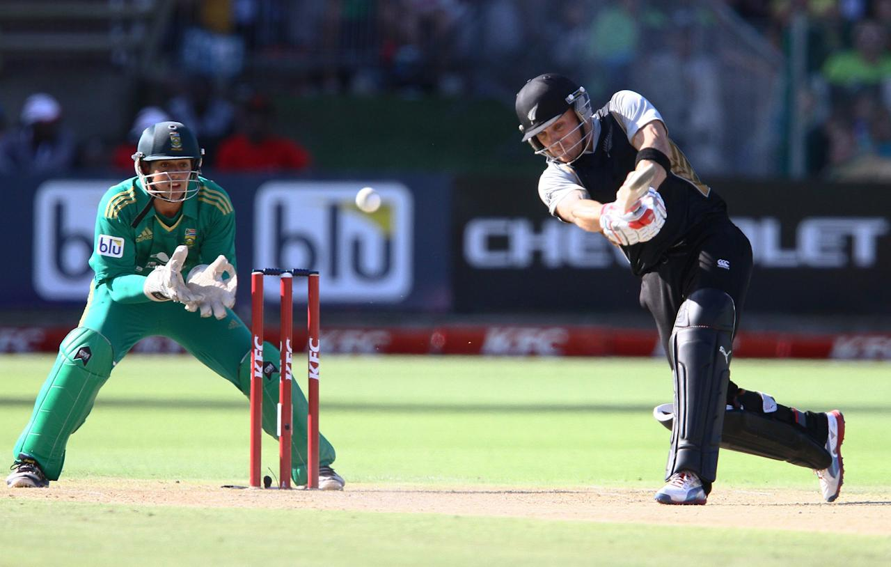 PORT ELIZABETH, SOUTH AFRICA - DECEMBER 26: Brendon McCullum of New Zealand drives one into the waiting hands of Justin Ontong of South Africa during the 3rd T20 International match between South Africa and New Zealand at AXXESS St Georges on December 26, 2012 in Port Elizabeth, South Africa. (Photo by Richard Huggard / Gallo Images/Getty Images)