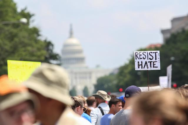 <p>Counter protesters gather at Freedom Plaza before the Unite the Right rally in Lafayette Park on August 12, 2018 in Washington, DC. Thousands of protesters are expected to demonstrate against the 'white civil rights' rally, which was planned by the organizer of last year's deadly rally in Charlottesville, Virginia. (Photo: Alex Wroblewski/Getty Images) </p>