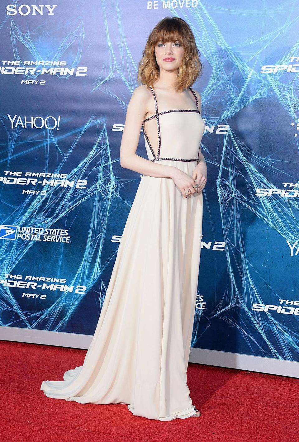 <p>Back as Gwen Stacy, Stone stopped for photographers at <em>The Amazing Spider-Man 2</em> premiere in New York on April 24, 2014. (Photo: Jamie McCarthy/Getty Images) </p>