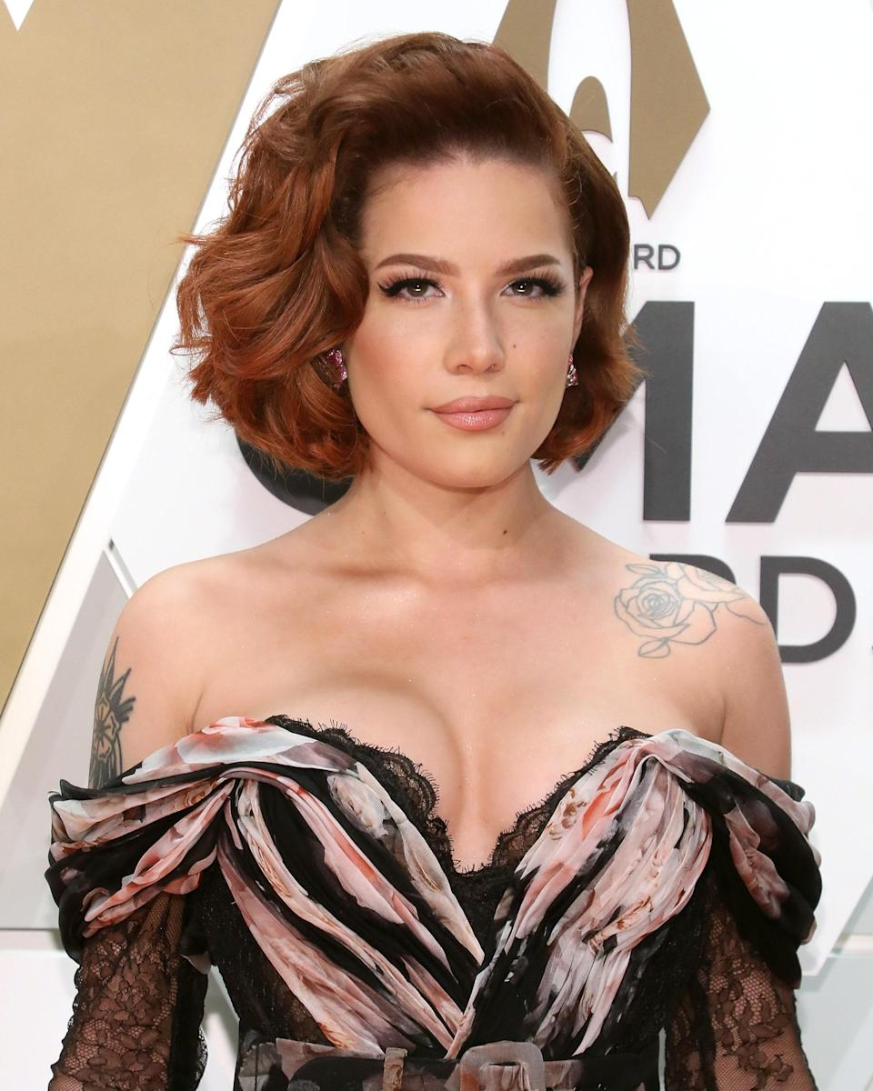 """Before she released her debut studio album <em>Badlands</em>, in 2015, singer Ashley Nicolette Frangipane came up with the stage persona that we all know her by today: Halsey. """"At the time, I felt that Ashley didn't deserve to be famous and successful because she wasn't that special, but if I made Halsey, maybe she could be,"""" the singer once <a href=""""https://www.dailymail.co.uk/tvshowbiz/article-8937201/Halsey-reveals-adopted-stage-didnt-deserve-famous.html"""" rel=""""nofollow noopener"""" target=""""_blank"""" data-ylk=""""slk:told Cosmopolitan"""" class=""""link rapid-noclick-resp"""">told <em>Cosmopolitan</em></a><em>.</em>"""