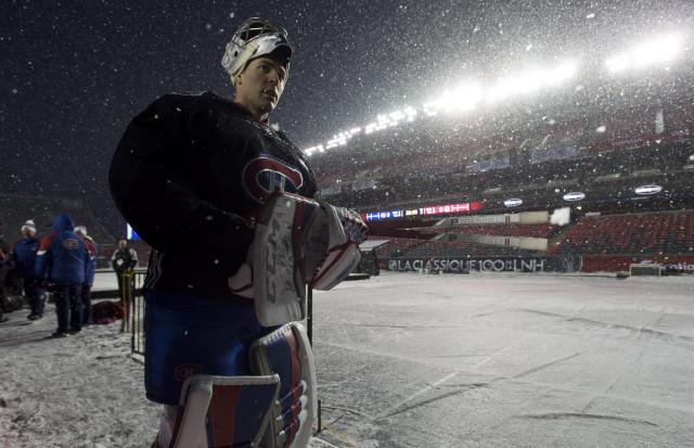 <p>Montreal Canadiens goalie Carey Price vacates the ice following an outdoor practice on a snowy Friday night in Ottawa. </p>
